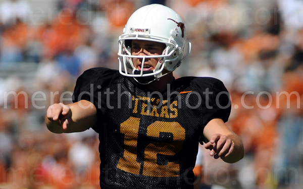 Colt McCoy directs his offensive line during the University of Texas Spring Jamboree.