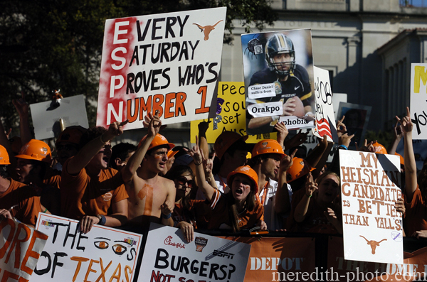 "exas Longhorns fans crowd the front row during broadcasting of ESPN's ""College GameDay"" at the University of Texas."