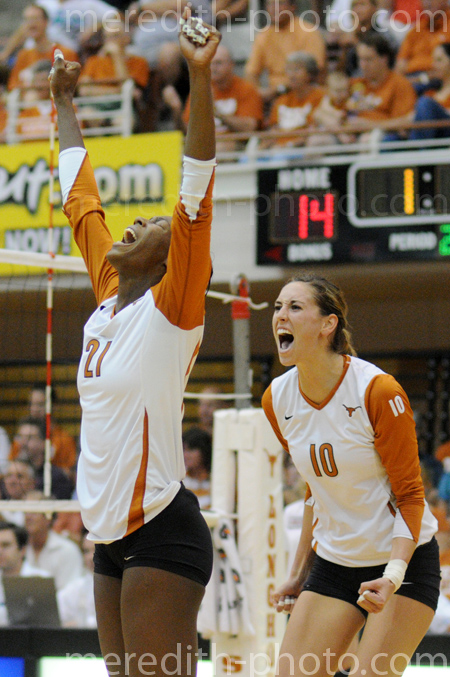 Destinee Hooker (#21) and Ashley Engle (#10) celebrate a point against Texas A&M.
