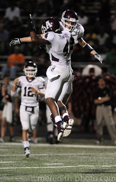 Cayleb Jones and Thomas Coffman celebrate Jones' touchdown reception in the second quarter during their game against Akins on Thursday.
