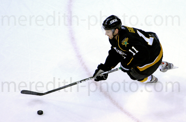Aaron Gagnon moves the puck during the Texas Stars opening game against San Antonio Rampage at the Cedar Park Center.
